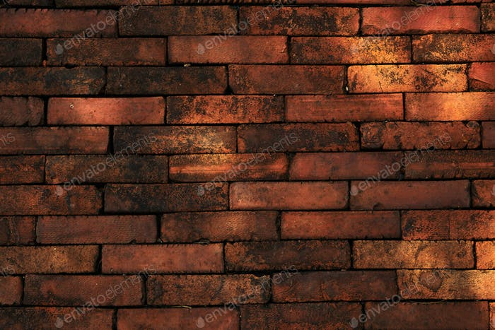 Background of the rough orange brick wall