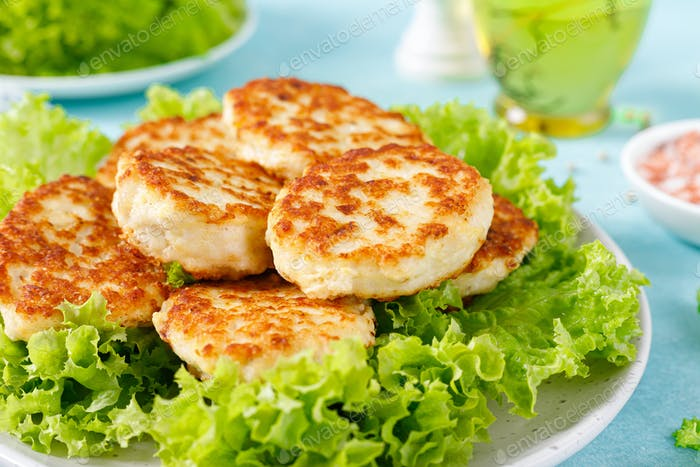 Chicken cutlets with fresh lettuce salad on plate