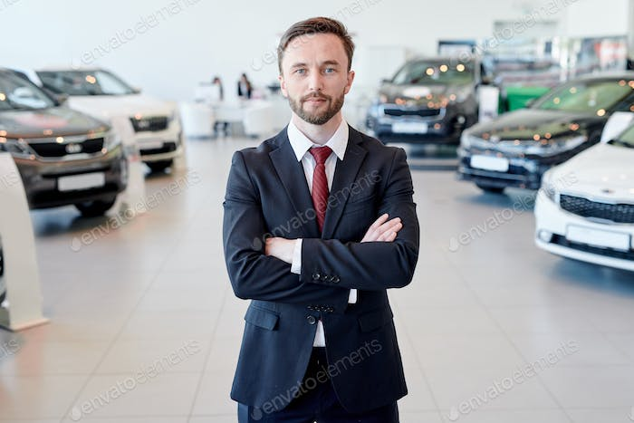 Car Salesman Posing in Showroom