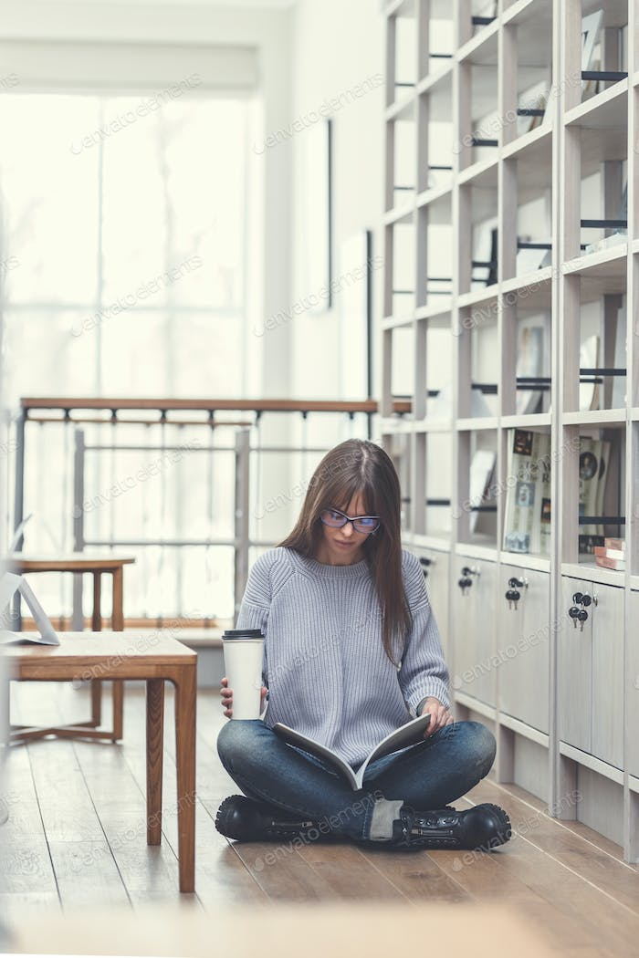 Attractive student reading a book
