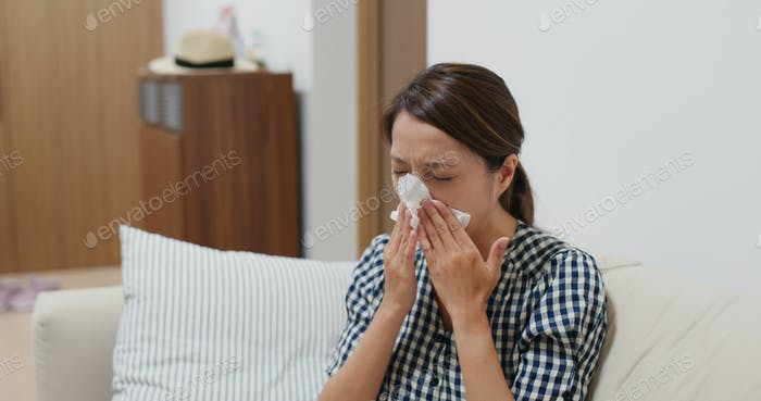 Woman got sick and sneeze at home