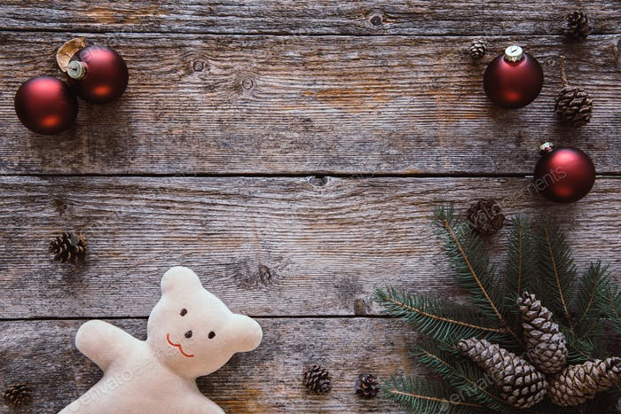 Christmas background with teddy bear. Space for text