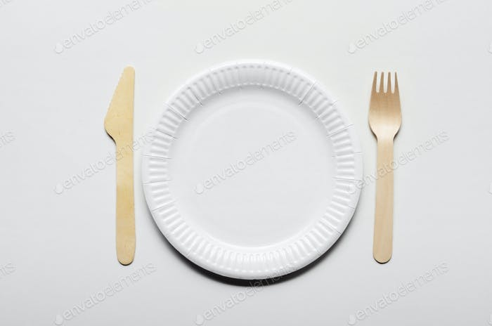 Wooden single use kitchenware and paper plate on white backgroun