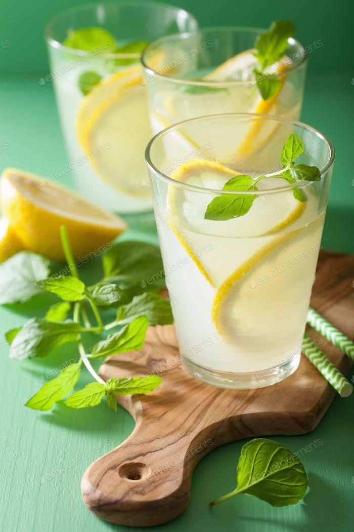 fresh lemonade drink with mint in glasses