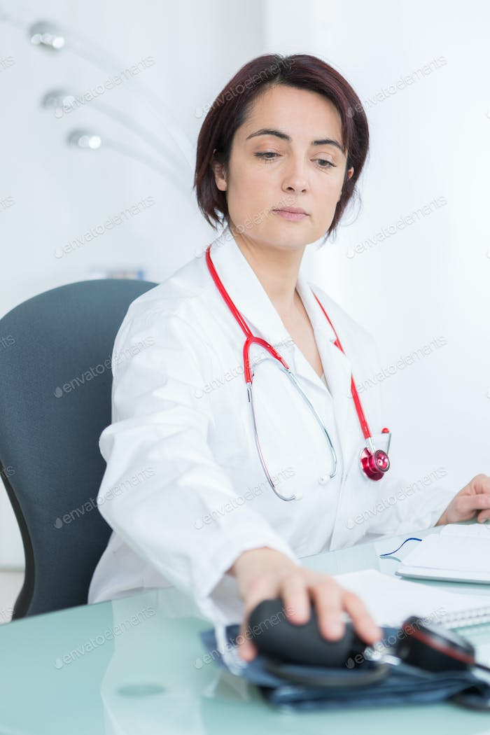 portrait of young female doctor in her office