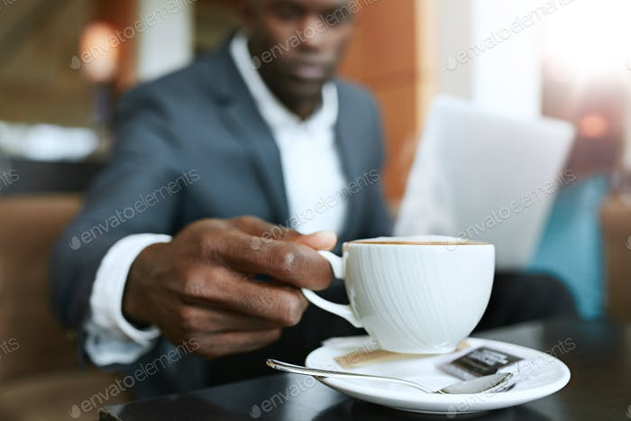 Businessman at hotel lobby drinking coffee