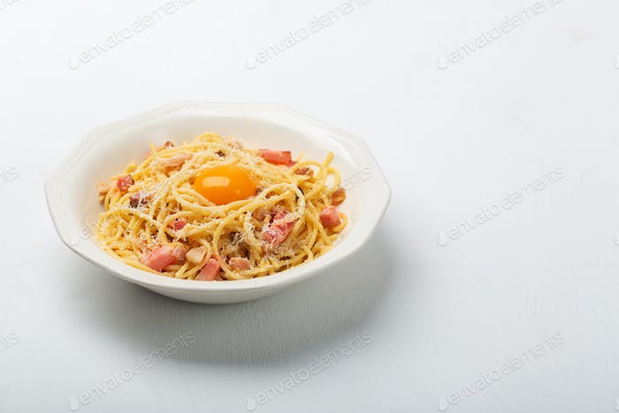 Italian pasta carbonara made with egg, hard cheese, cured pork guanciale or pancetta