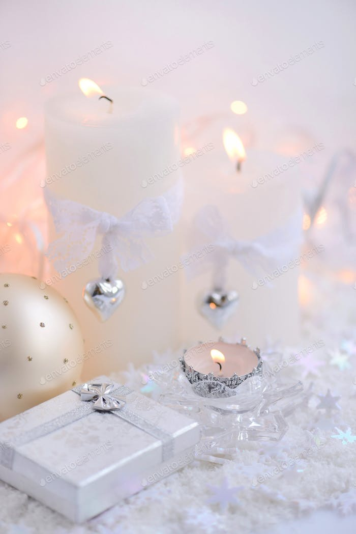 Christmas candles with Christmas baubles and Christmas lights. F