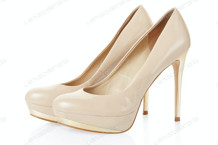 High heel beige shoes pair on white