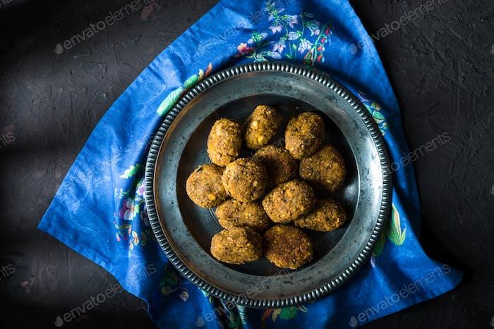 Vegan falafel on a tin plate on a blue napkin