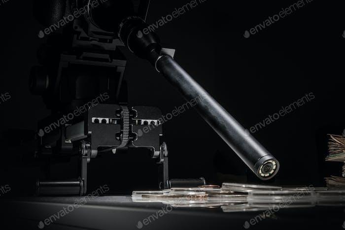 Cámara con lente macro sonda en el deslizador de toma de fotos