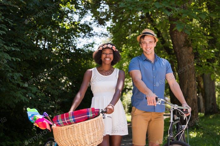 Young  couple having joyful bike ride in nature