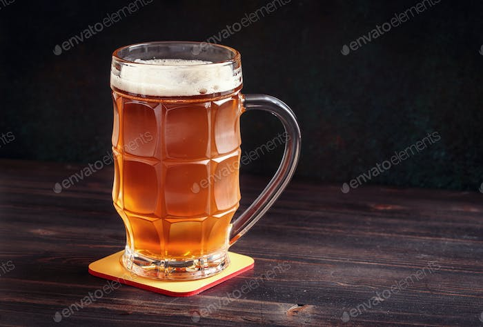 Lager beer mug on wooden table