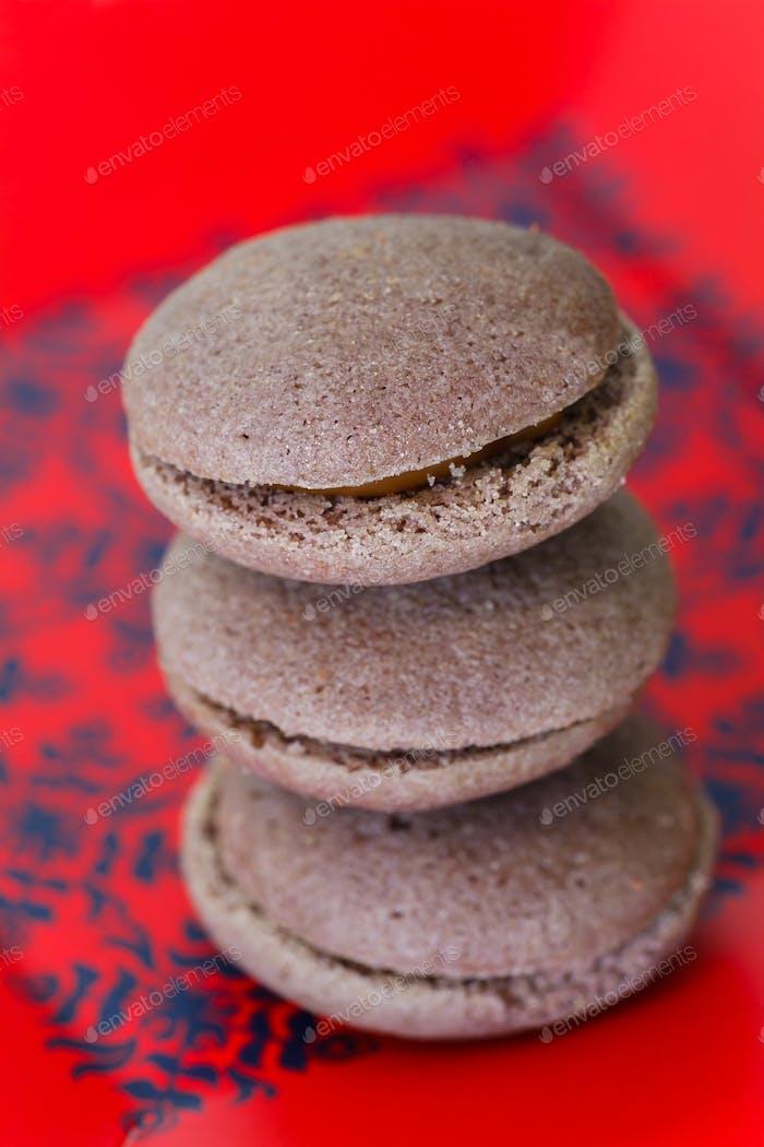 Chocolate marron cookies with black chocolate cream