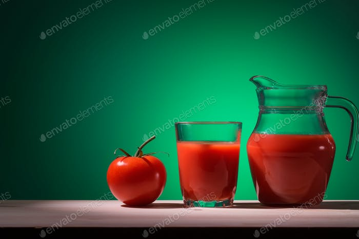 Tomato glass and jug with tomato juice