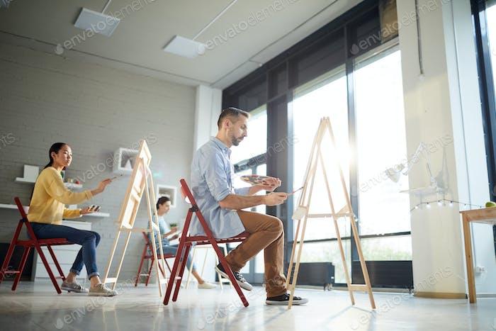 Painting in artwork studio
