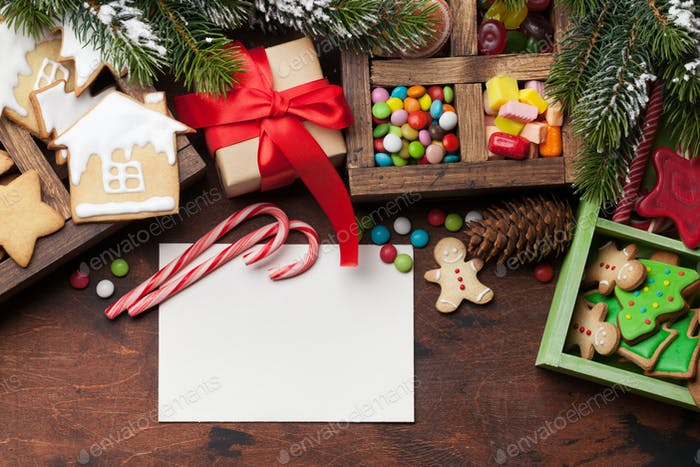 Christmas card with sweets, gift box and fir tree