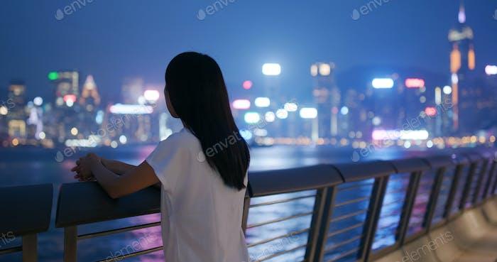 Woman look at the sea at night
