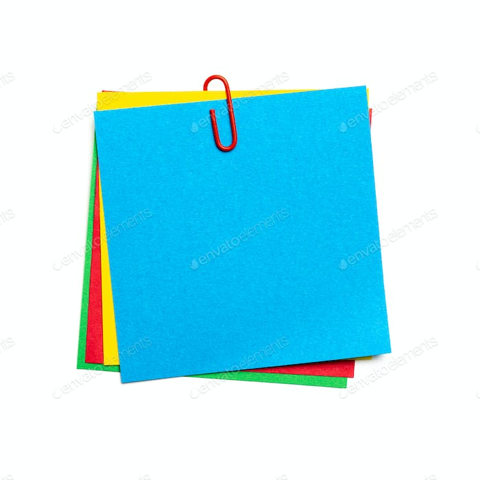 Blue stick note with paper clip isolated