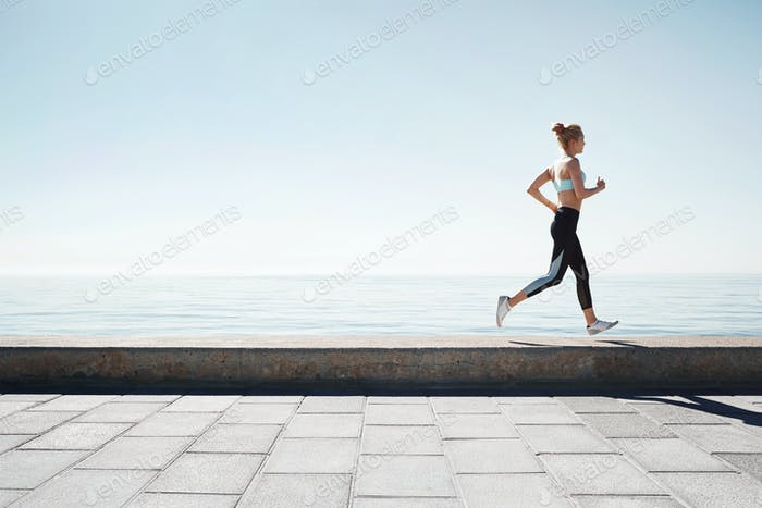 Running asian woman. Female runner training outdoors seaside ath