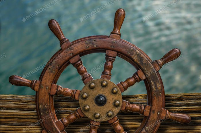 Ship's Wheel Against Water