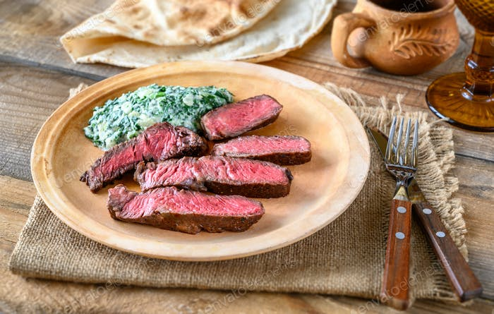 Beef steak with creamy spinach