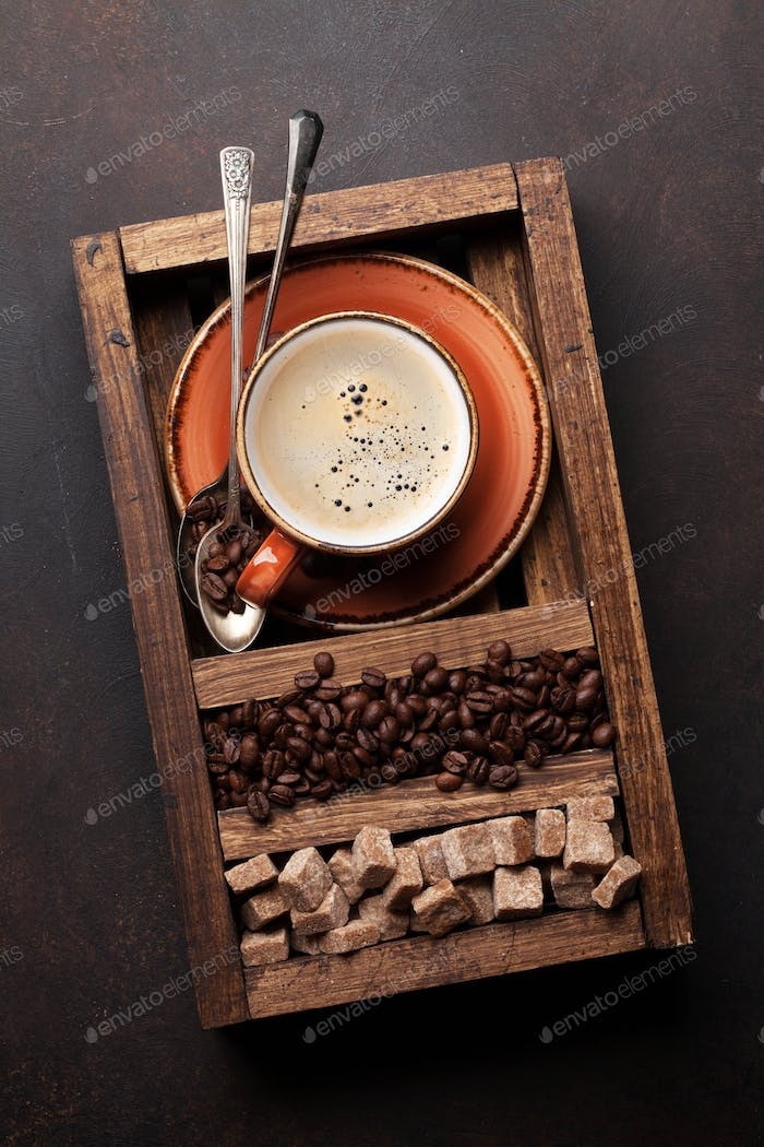 Coffee cup, roasted beans and brown sugar
