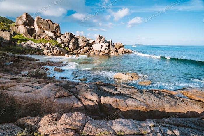La Digue island, Seychelles. Tropical coastline with hidden beach, unique granite rocks in evening
