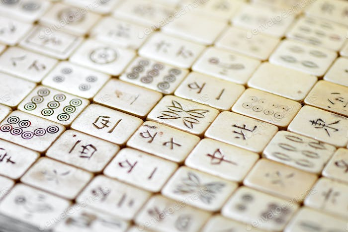 Close up on old Mahjong tiles with Chinese script