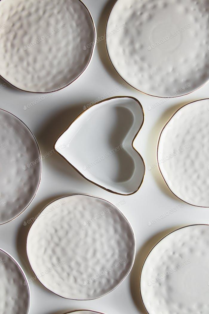 Beautiful plates on a white background with cotton. Beautiful layout