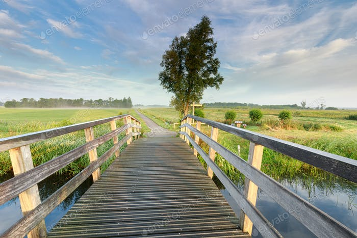 bridge via river in morning countryside