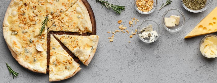 Cheesy pizza and various types of cheeses