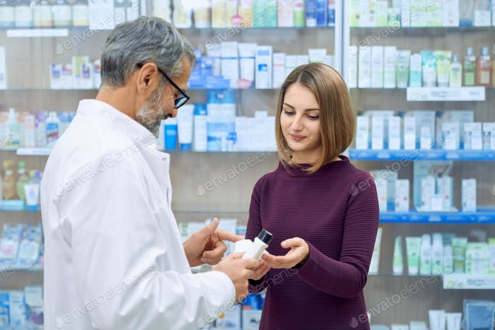 Pharmacist helping woman in medicine choice
