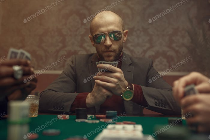 Professional poker player playing in casino