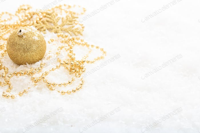 Christmas ball and snow on white background