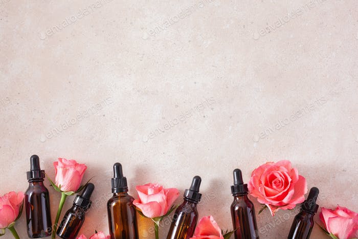 essential oils in bottles rose flowers. alternative medicine aromatherapy