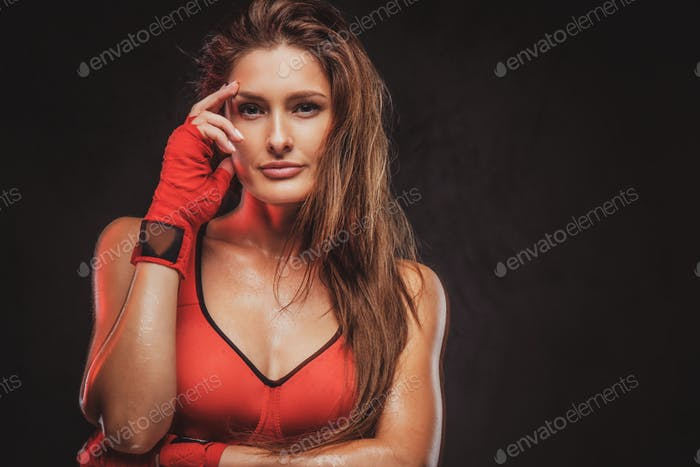 Portrait of beautiful woman in red sporty bra