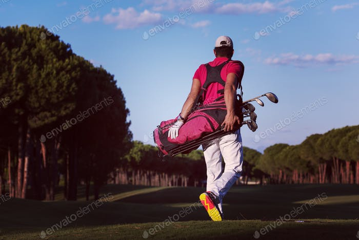 golfer  walking and carrying golf  bag