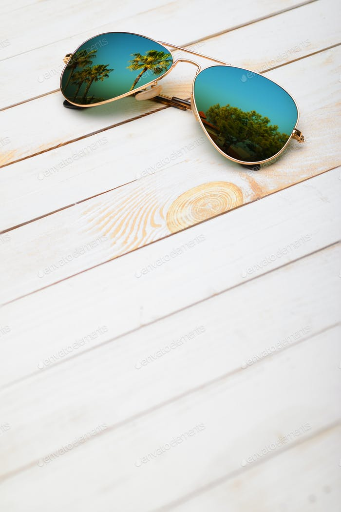 Sunglasses on wooden planks