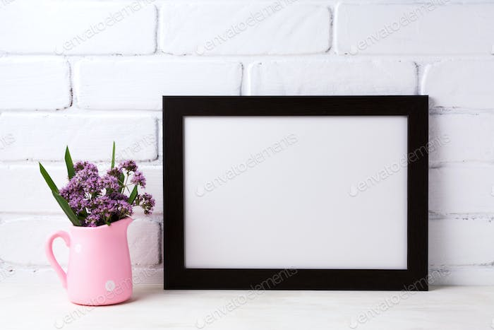 Black brown  landscape frame mockup with purple flowers in pink