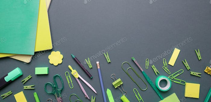 Flat lay of office, school stationery on grey background