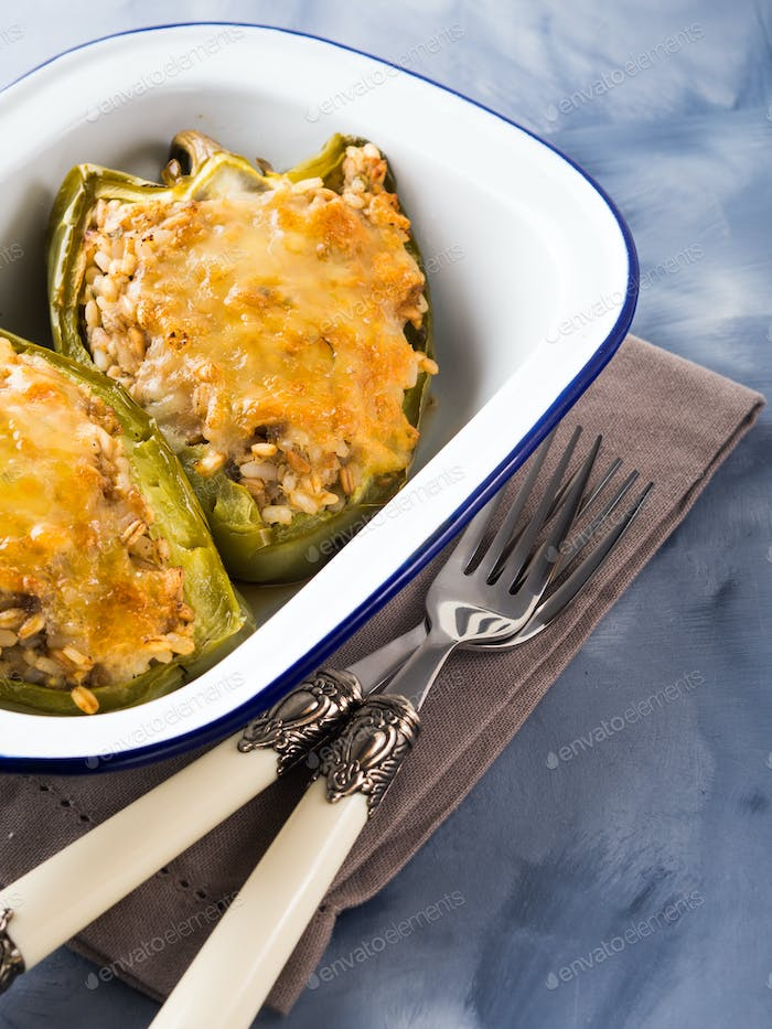Green Bell peppers stuffed with cereal and meat