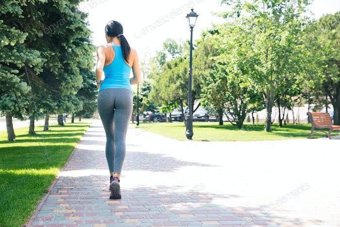 Sports woman running outdoors