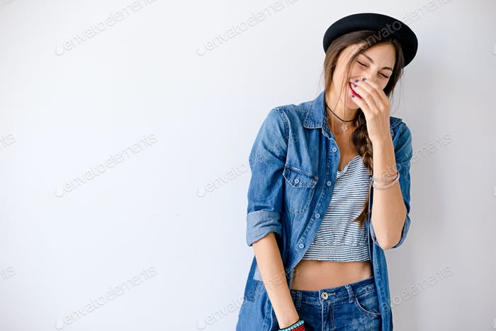 Portrait happy girl with closed eyes on white background