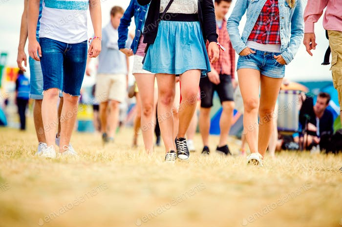 Unrecognizable teenagers, tent music festival, sunny summer, leg