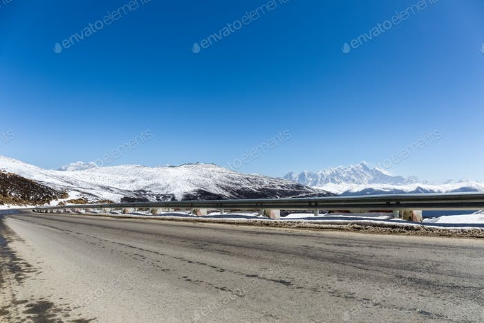 highway with snow mountain