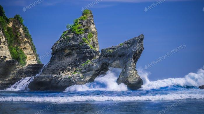 Huge Wave hitting the Rock in the ocean at Atuh beach on Nusa Penida island, Indonesia