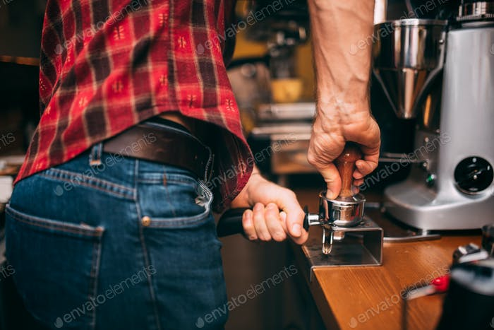 professional bartender making coffee and preparing tamper