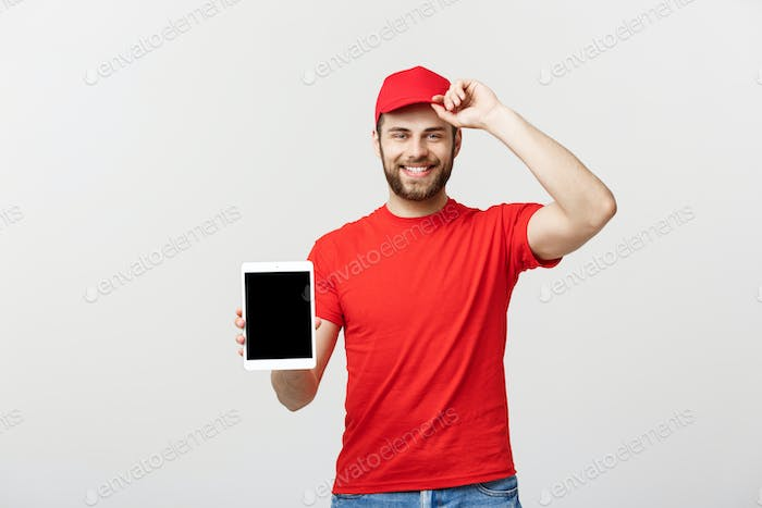 Online shopping, delivery, technology and lifestyle concept - smiling delivery man presenting tablet