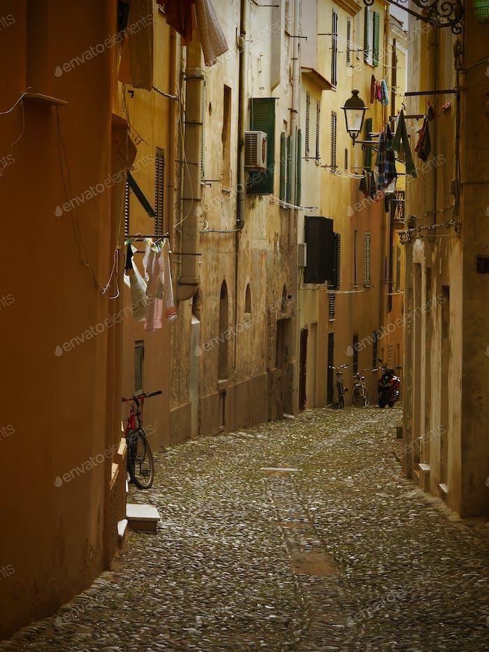 Narrow dark italian alley